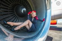 Flight attendant posing at an engine